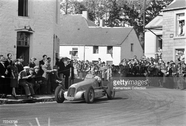 Prince Bira of Siam corners his Maserati 4CL at La Bouchre corner in the village of Chimay in Belgium during the Grand Prix des Frontires 25th July...