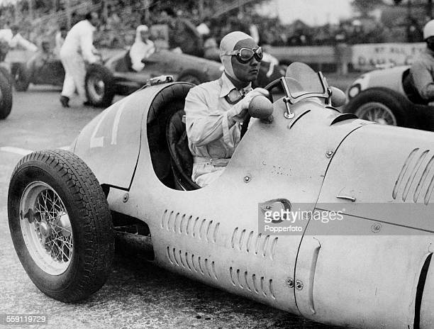 Prince Bira of Siam sits aboard the Enrico PlatE Maserati 4CLT/48 Maserati Straight4 s before the start of the Chichester Cup for Formula Libre race...