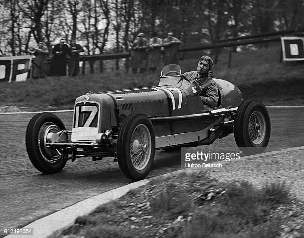 Prince Birabongse of Siam better known to the English public as B Bira the racing motorist drives a car on the track at Crystal Palace 'B Bira' at...