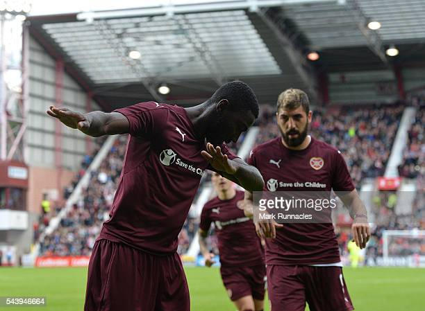 Prince Buaben of Hearts celebrates scoring from the penalty spot during the UEFA Europa League First Qualifying Round match between Heart of...