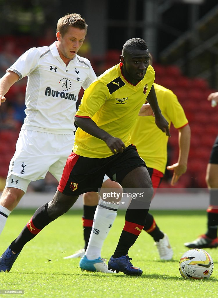 Prince Buaben of Watford moves away with the the ball from Gylfi Sigurdsson of Tottenham Hotspur during the pre-season friendly match between Watford and Tottenham Hotspur at Vicarage Road on August 5, 2012 in Watford, United Kingdom.