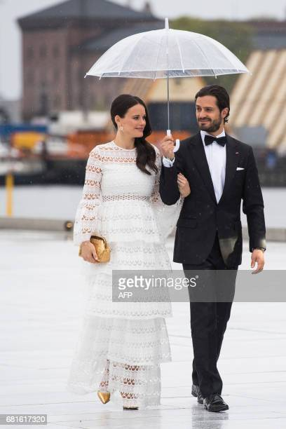 Prince Carl Philip and princess Sofia of Sweden arrive for a gala dinner at the Operahouse in Oslo on May 10 2017 in celebration of the 80th bithdays...