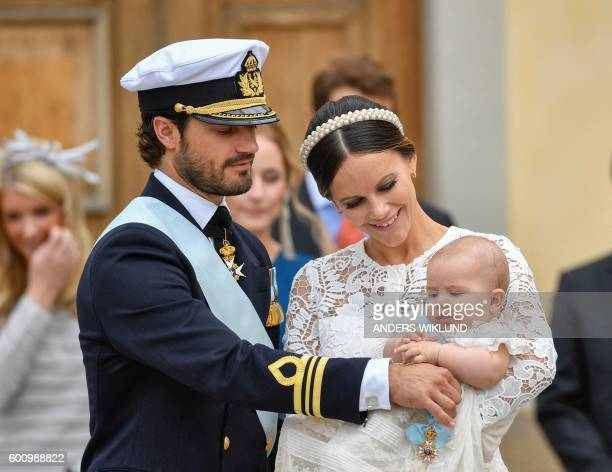 Prince Carl Philip and Princess Sofia with Prince Alexander are pictured at Palace Chapel in Drottningholm Palace in Stockholm during the christening...