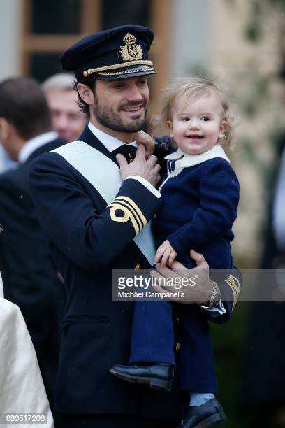 Prince Carl Philip holding Prince Alexander Duke of Sodermanland attends the christening of Prince Gabriel of Sweden at Drottningholm Palace Chapel...