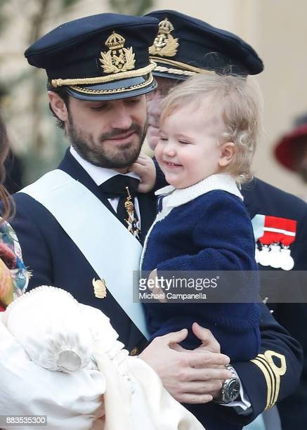 Prince Carl Philip holding Prince Alexander Duke of Sodermanland leaves the chapel after the christening of Prince Gabriel of Sweden at Drottningholm...