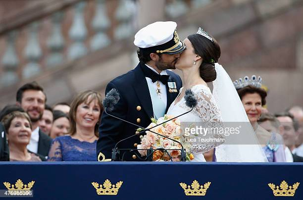 Prince Carl Philip of Sweden and his wife Princess Sofia of Sweden kiss on the balcony after their royal wedding at The Royal Palace on June 13 2015...