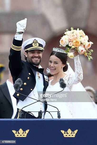 Prince Carl Philip of Sweden and his wife Princess Sofia of Sweden salute the crowd after their marriage ceremony on June 13 2015 in Stockholm Sweden