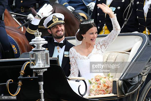 Prince Carl Philip of Sweden and his wife Princess Sofia of Sweden ride in the wedding cortege after their marriage ceremony on June 13, 2015 in...
