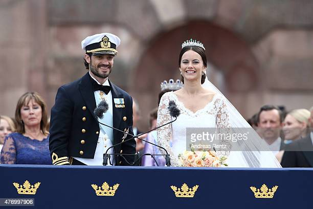 Prince Carl Philip of Sweden and HRH Princess Sofia, Duchess of Varmland ride in the wedding cortege after their marriage ceremony on June 13, 2015...