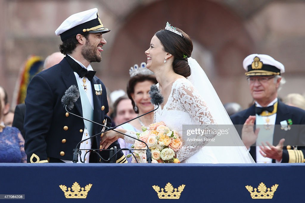 Prince Carl Philip of Sweden and HRH Princess Sofia, Duchess of Varmlands salute the crowd after their marriage ceremony on June 13, 2015 in Stockholm, Sweden.