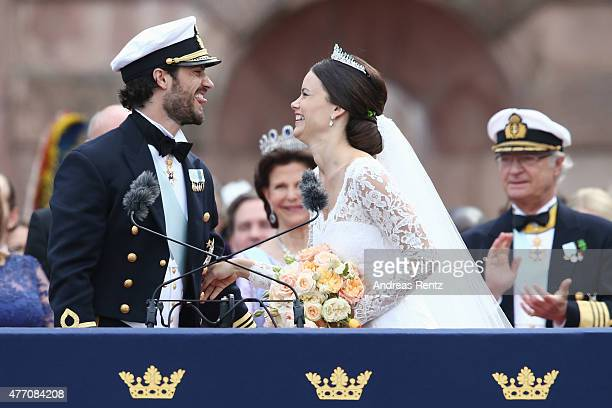 Prince Carl Philip of Sweden and HRH Princess Sofia Duchess of Varmlands salute the crowd after their marriage ceremony on June 13 2015 in Stockholm...