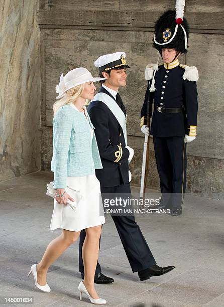 Prince Carl Philip of Sweden and Prince Daniel's older sister Anna Westling Soderstrom arrive on May 22 2012 for the christening of Princess Estelle...