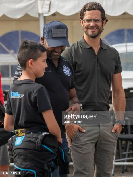 Prince Carl Philip of Sweden attends the price giving ceremony for the Prince Carl Philip Racing Trophy at the Lidkoping Open carting competition on...