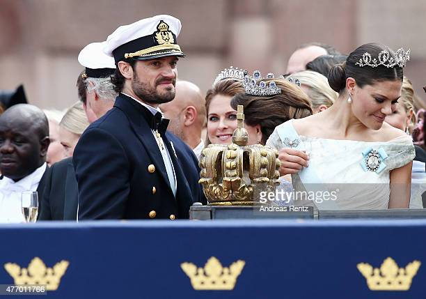 Prince Carl Philip of Sweden gestures as he stands next to his sister Crown Princess Victoria of Sweden after his marriage ceremony to Princess Sofia...
