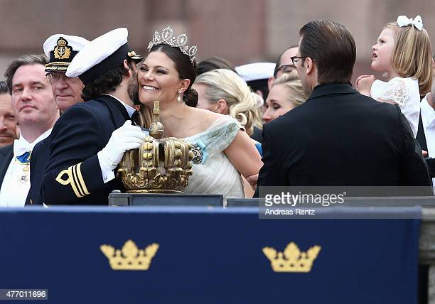 Prince Carl Philip of Sweden places one hand on the crown as he chats with his sister Crown Princess Victoria of Sweden after his marriage ceremony...