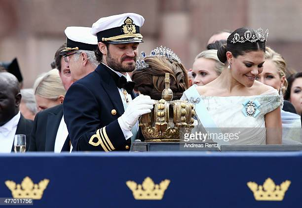 Prince Carl Philip of Sweden places one hand on the crown as he stands next to his sister Crown Princess Victoria of Sweden after his marriage...