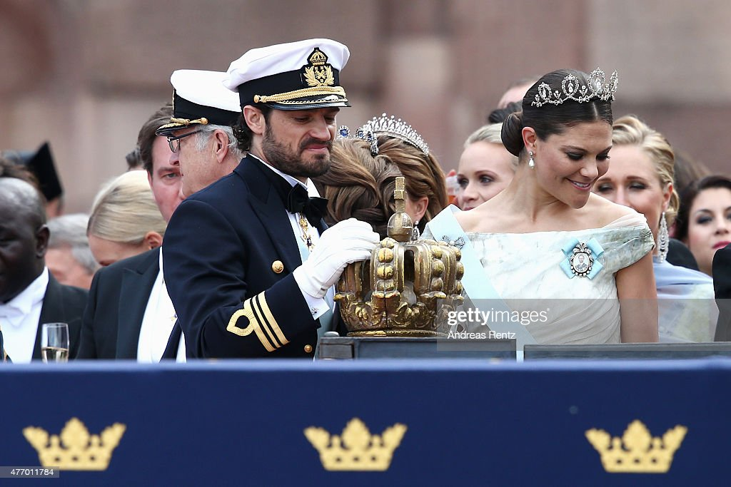 Prince Carl Philip of Sweden places one hand on the crown as he stands next to his sister, Crown Princess Victoria of Sweden, after his marriage ceremony to Princess Sofia, at The Royal Palace on June 13, 2015 in Stockholm, Sweden. In 1980, Sweden became the first monarchy to change its succession rites so that the first-born child of the monarch is heir to the throne, regardless of gender.