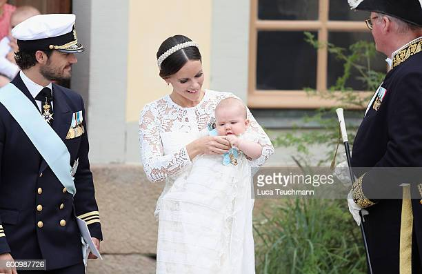 Prince Carl Philip of Sweden Princess Sofia of Sweden their son Prince Alexander and King Carl XVI Gustaf of Sweden attend the christening of Prince...