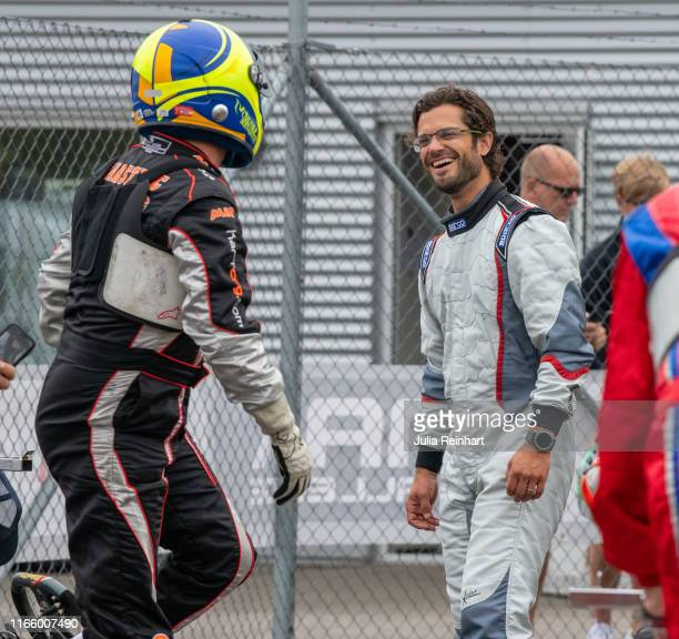 Prince Carl Philip of Sweden shares a laugh with his racing partner Per Wilander after they participated in the DD2 Masters Class in the Lidkoping...
