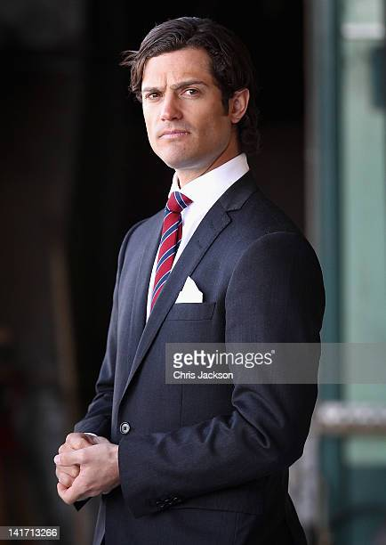 Prince Carl Philip of Sweden waits to greet Camilla Duchess of Cornwall and Prince Charles Prince of Wales as they arrive at Arlanda Airport on March...