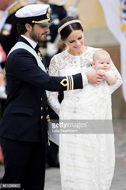 Prince Carl Philip, Princess Sofia and Prince Alexander attend the christening of Prince Alexander of Sweden at Drottningholm Palace Chapel on...
