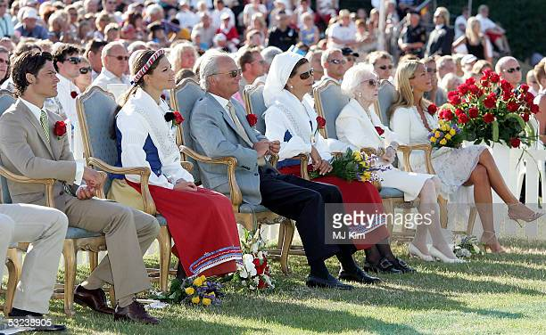 Prince Carl Philip, Princess Victoria, King Carl Gustav, Queen Sylvia, Princess Lilian and Princess Madeleine are seen at a concert during...