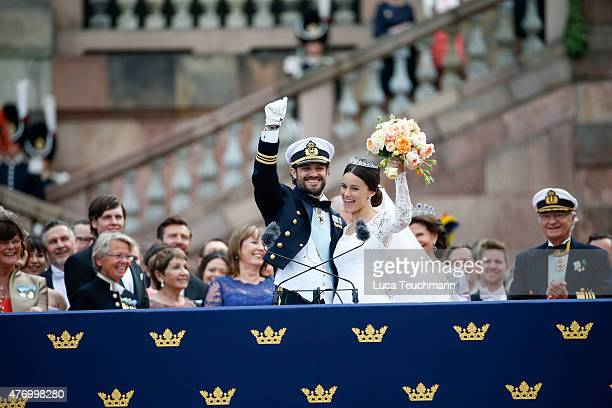 Prince Carl Philip and Princess Sofia of Sweden greet the crowd after their marriage at the Royal Palace Chapel on June 13 2015 in Stockholm Sweden