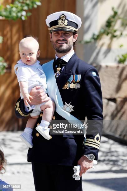 Prince Carl Phillip of Sweden holding Prince Gabriel of Sweden poses after the christening of Princess Adrienne of Sweden at Drottningholm Palace...