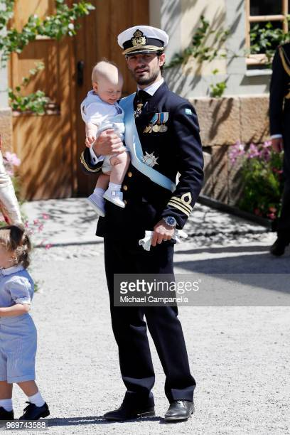 Prince Carl Phillip of Sweden holding Prince Gabriel of Sweden poses after the christening of Princess Adrienne of Sweden at Drottningholm Palace...