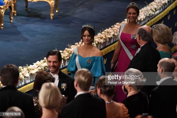Prince Carl Phillip of Sweden Princess Sofia of Sweden and Princess Madeleine of Sweden attend the Nobel Prize Awards Ceremony at Concert Hall on...