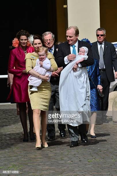 Prince Carlos Xavier de Bourbon de Parma and Princess Annemarie Gualthérie van Weezel stand with their daughters Luisa Irene Constance Anna Maria...