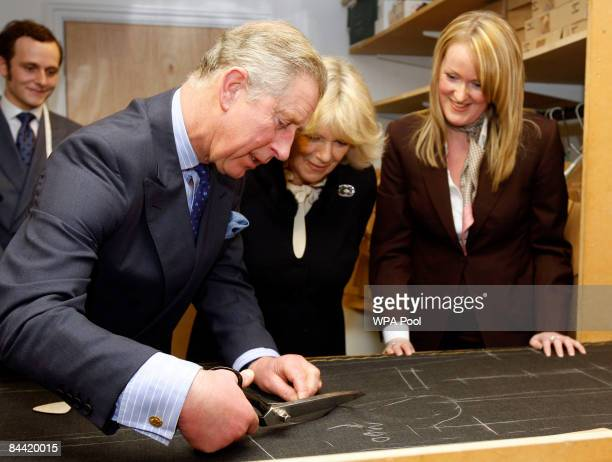 Prince Charles and Camilla Duchess of Cornwall are seen with cutter Kathryn Sargent during a visit to Gieves Hawkes a bespoke tailor on January 23...