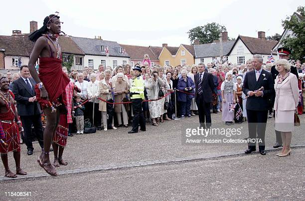 Prince Charles and Camilla Duchess of Cornwall meet a touring troupe of Masai Warriors on a visit to the Suffolk village of Lavenham on July 22 2005