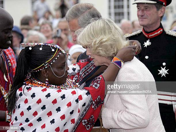 Prince Charles and Camilla Duchess of Cornwall who is presented with a Masai necklace meet a touring troupe of Masai Warriors on a visit to the...