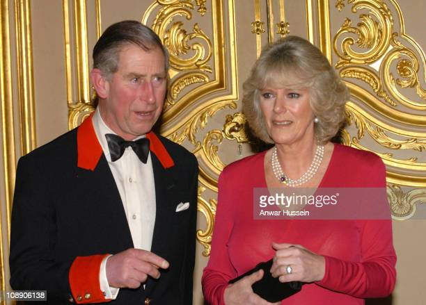 Prince Charles and Camilla Parker Bowles arrive for a party at Windsor Castle after announcing their engagement earlier 10 February, 2005. Britain's...