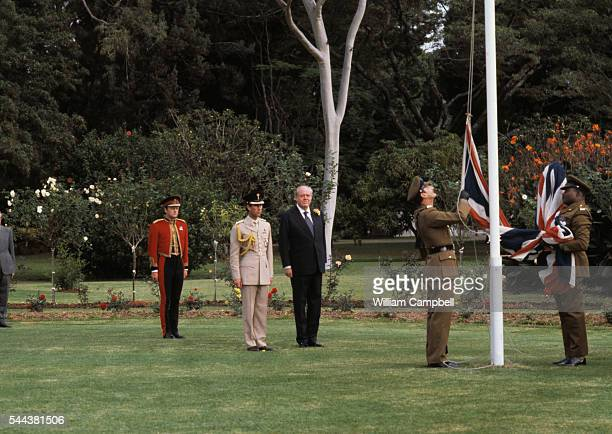 Prince Charles and Christopher Soames watch the Union Jack lowered as Southern Rhodesia becomes the nation of Zimbabwe
