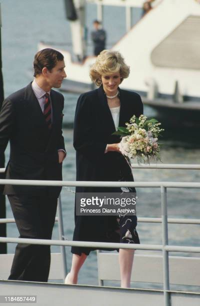Prince Charles and Diana, Princess of Wales after a visit to a church in Milan, Italy, April 1985. Diana is wearing a Jan Van Velden coat.