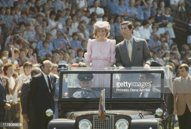 Prince Charles and Diana Princess of Wales are driven through Newcastle during their tour of Australia March 1983 Diana is wearing a pink Catherine...