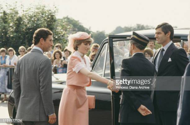 Prince Charles and Diana, Princess of Wales arrive at Romsey Station in England at the end of their wedding day, 29th July 1981. She is wearing an...