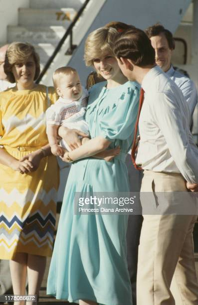 Prince Charles and Diana, Princess of Wales arrive in Alice Springs, Australia, with their son Prince William, March 1983.