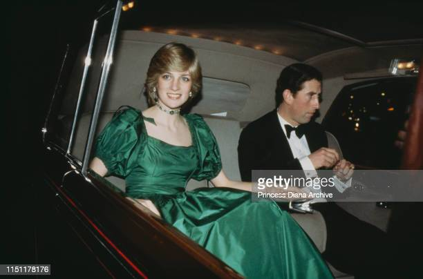Prince Charles and Diana, Princess of Wales attend a concert at the Barbican Centre in London, 26th October 1982. Diana is wearing a green ballgown...