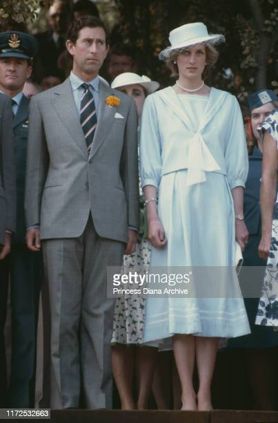Prince Charles and Diana Princess of Wales attend a garden party in Government House Australia April 1983 Diana is wearing a suit by Catherine Walker