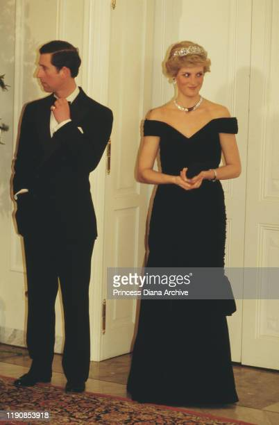 Prince Charles and Diana, Princess of Wales attend a presidential state banquet in Bonn, Germany, 2nd November 1987. Diana is wearing an evening gown...
