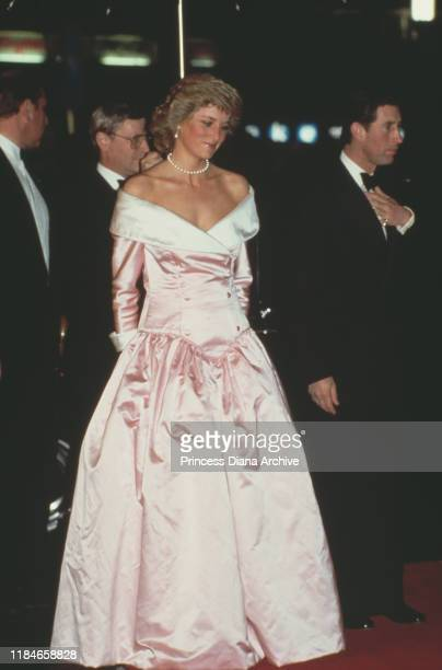 Prince Charles and Diana, Princess of Wales attend the ballet in Berlin, Germany, November 1987. Diana is wearing an evening gown by Catherine Walker.