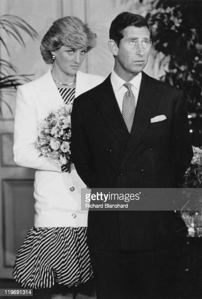 Prince Charles and Diana Princess of Wales attend the Cannes Film Festival France 15th May 1987 Diana is wearing a striped puffball dress with a...