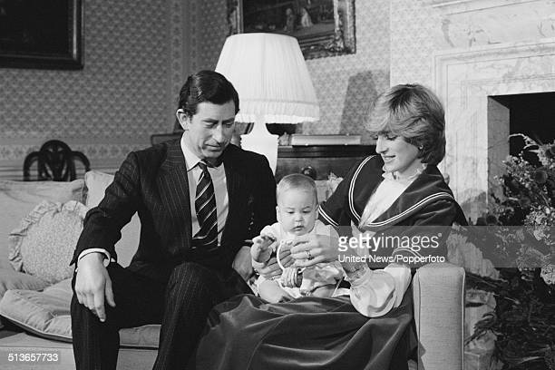 Prince Charles and Diana Princess of Wales hold their baby son Prince William at Kensington Palace in London on 22nd December 1982