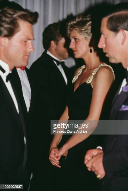 Prince Charles and Diana, Princess of Wales meet actor Kurt Russell at the London premiere of the film 'Backdraft', 22nd July 1991. Diana is wearing...