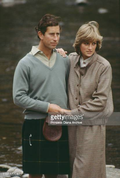 Prince Charles and Diana Princess of Wales on the banks of the River Dee in Balmoral Scotland at the end of their honeymoon September 1981 She is...