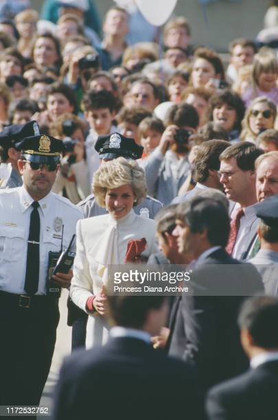 Prince Charles and Diana Princess of Wales visit a JC Penney store in Springfield Virginia USA 11th November 1985 They are escorted by SD Danzig...