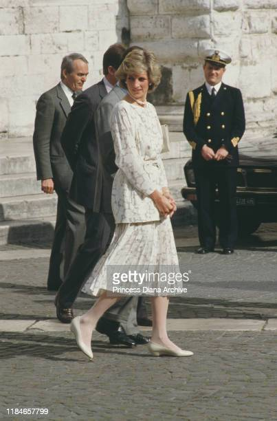 Prince Charles and Diana, Princess of Wales visit Apulia in Italy, April 1985. Diana is wearing a suit by Jasper Conran.